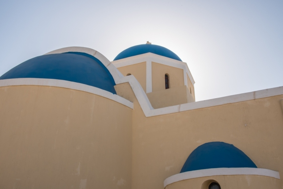 a-close-up-of-the-beige-greek-orthodox-church-oia-santorini-island-greece