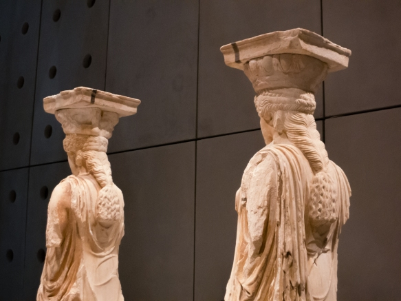 a-close-up-of-the-hair-of-two-of-the-cleaned-and-restored-original-five-out-of-the-six-statues-of-korai-caryatids-which-supported-the-roof-of-the-south-porch-of-the-erechtheion-temple-on-the-acrop