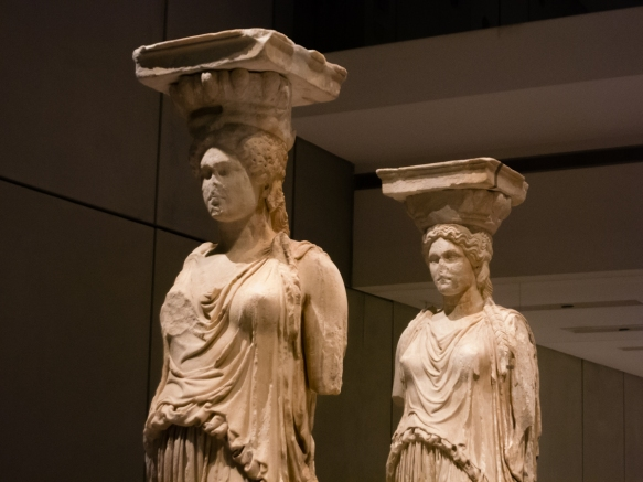 a-close-up-of-two-of-the-cleaned-and-restored-original-five-out-of-the-six-statues-of-korai-caryatids-which-supported-the-roof-of-the-south-porch-of-the-erechtheion-temple-on-the-acropolis-see-ou