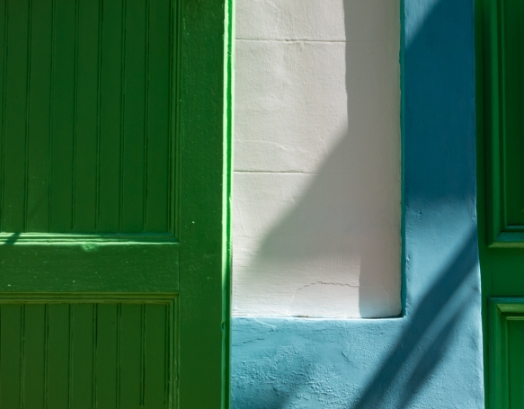 A colorful geometric pattern from adjacent doors in the town of Santa Marina, Isola di Salina, Italy