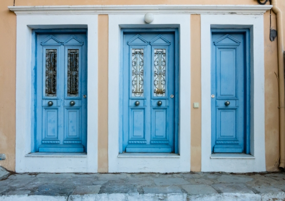 a-composition-of-greek-blue-doors-in-old-town-symi-greece