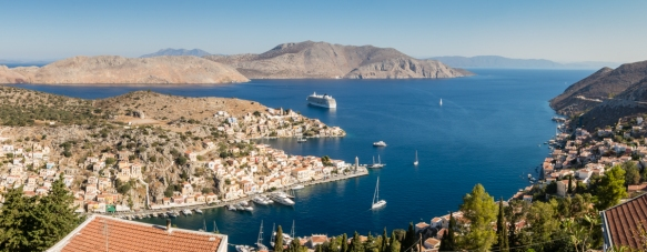 a-panorama-of-the-harbors-and-town-of-symi-greece-taken-from-the-church-courtyard-atop-the-old-town-after-hiking-up-the-hillside
