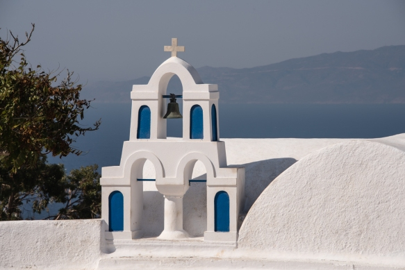 a-picturesque-bell-tower-on-a-church-in-the-center-of-oia-santorini-island-greece