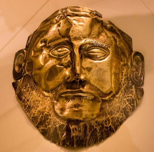 a-replica-of-the-gold-death-mask-of-agamemnon-king-of-mycenae-and-leader-of-the-greek-army-attacking-troy-discovered-in-1867-by-heinrich-schliemann-referred-to-as-the-mona-lisa