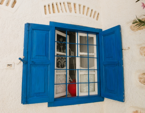 a-typical-window-in-the-medieval-venetian-kastro-castle-neighborhood-chora-folegandros-island-cyclades-greece