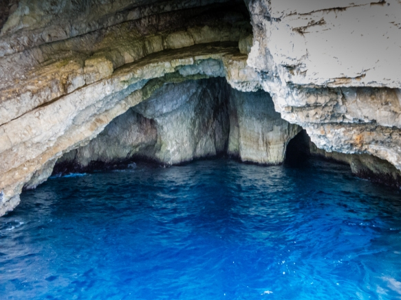 """As we cruised along and partially inside the so-called """"Blue Caves"""", it was easy to see why the caves are so named; Cape Komouto, Zakynthos (Zante), Greece"""