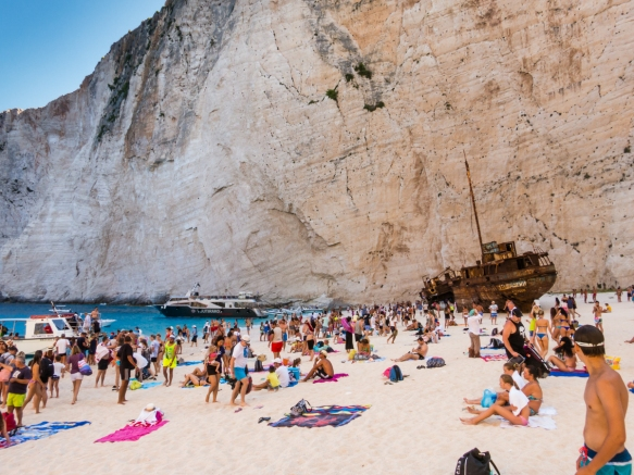 As we left mid-morning, there were already many 100's of people on the beach; by mid-afternoon there are typically up to 2,500 people on the beach and the cove is jammed with boats, Navagio (Shipwreck) Beach, Zakynthos (Zante), Greece