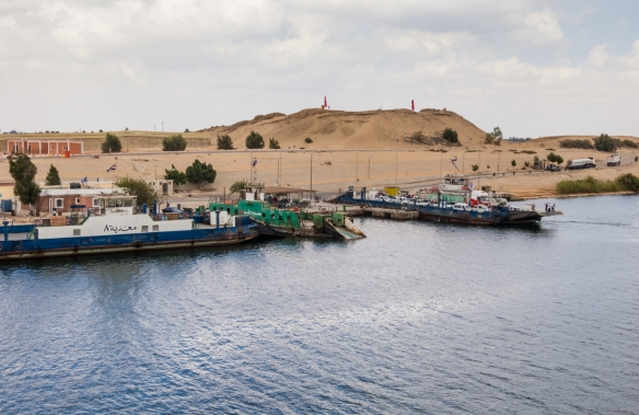 because-there-is-only-one-automobile-truck-bridge-and-one-railway-bridge-crossing-the-suez-canal-egypt-there-are-numerous-car-ferries-that-cross-the-short-distance-between-the-two-shores