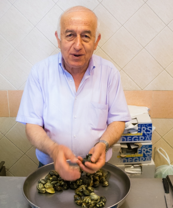 Franco selecting the freshest clams for us at his fish market in Gaeta, Italy; while he spoke only Italian, we were fortunate that a younger patron at the store spoke English & could translate for us – all the locals we met were cheerful and helpful