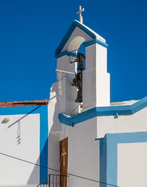 greek-orthodox-church-bell-tower-in-old-town-symi-greece