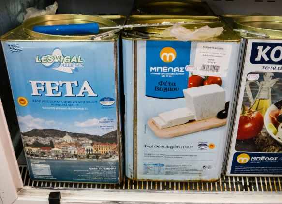 locals-buy-feta-cheese-from-these-large-metal-containers-in-the-refrigerator-section-of-the-local-grocery-store-chora-folegandros-island-cyclades-greece