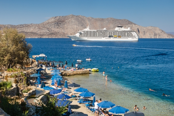 our-ship-anchored-outside-the-harbor-of-symi-greece-viewed-from-the-hiking-trail-above-a-private-beach-club-and-restaurant-on-the-point_