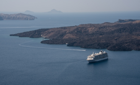 our-ship-was-anchored-in-athinios-bay-between-fira-and-the-young-volcanic-island-of-nea-kameni-fira-santorini-island-greece-because-the-caldera-water-is-so-deep-ships-can