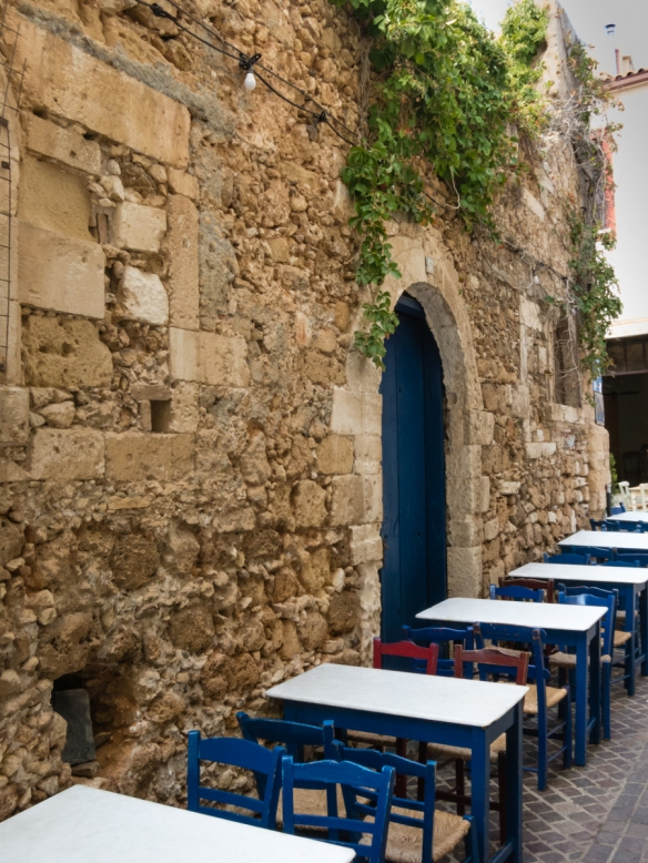 outdoor-tables-at-taman-restaurant-located-in-an-old-turkish-hammam-public-baths-in-old-town-chania-crete-greece