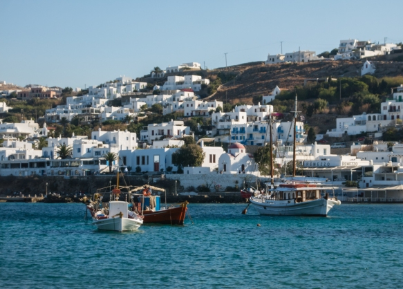 sailing-into-mykonos-harbor-the-first-thing-you-notice-are-the-white-houses-cascading-down-to-the-waterfront-mykonos-town-mykonos-cyclades-greece