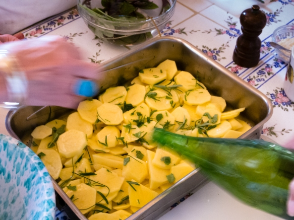 Sliced potatoes with rosemary & Italian parsley tossed with olive oil & salt were baked in the oven to accompany veal scallopini that was slowly cooked in olive oil over medium heat and then served with a wine sauce, Villa Ida, Sorrento, Italy
