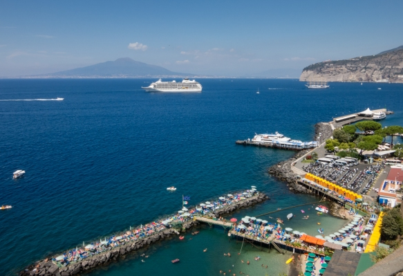 Sorrento Harbor in the Bay of Naples, looking north to Mount Vesuvius across the bay, Sorrento, Italy