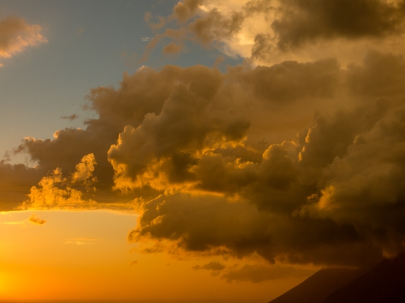 Sun-lit clouds at sunset viewed from the vineyards of Tenuta di Castellaro winery, Lipari, Italy
