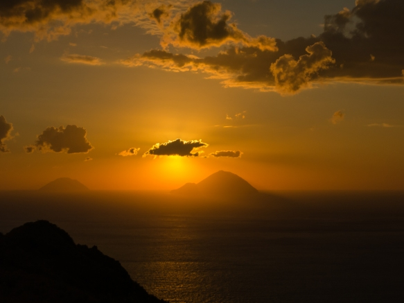 Sunset over neighboring islands viewed from the vineyards of Tenuta di Castellaro winery, Lipari, Italy