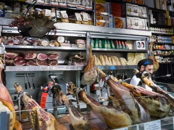 The deli meat counter is the first thing you see when walking through the front doors of Salumeria Roscioli, Roma, Italy; the dining areas are in the rear of the streel level floor and downstairs amidst their wine collection