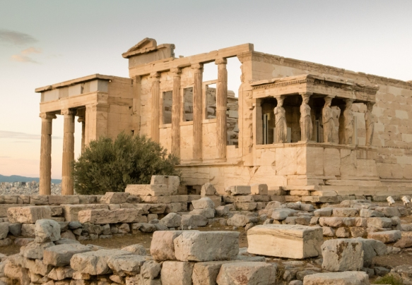 the-erechtheion-on-the-north-side-of-the-acropolis-across-from-the-parthenon-was-an-ancient-greek-temple-dedicated-to-both-athena-and-poseidon-with-the-famous-porch-of-the-caryatids-athens-greece
