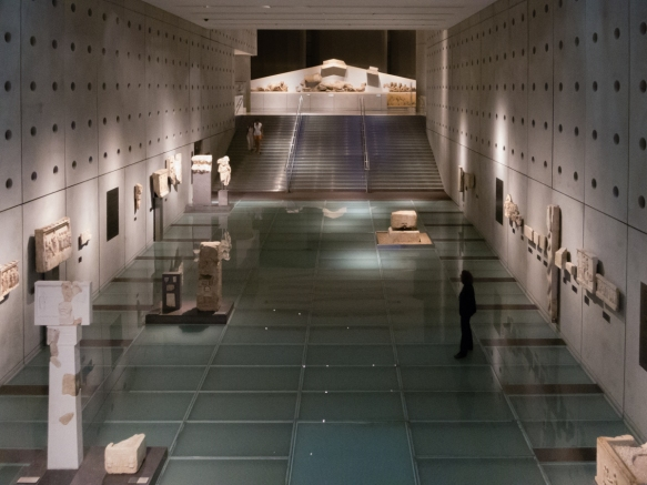 the-glass-floored-ground-level-gallery-housing-artifacts-from-the-slopes-of-the-acropolis-the-new-acropolis-museum-athens-greece-the-occasionally-transparent-floor-provides-a-view-of-the-archaeolo
