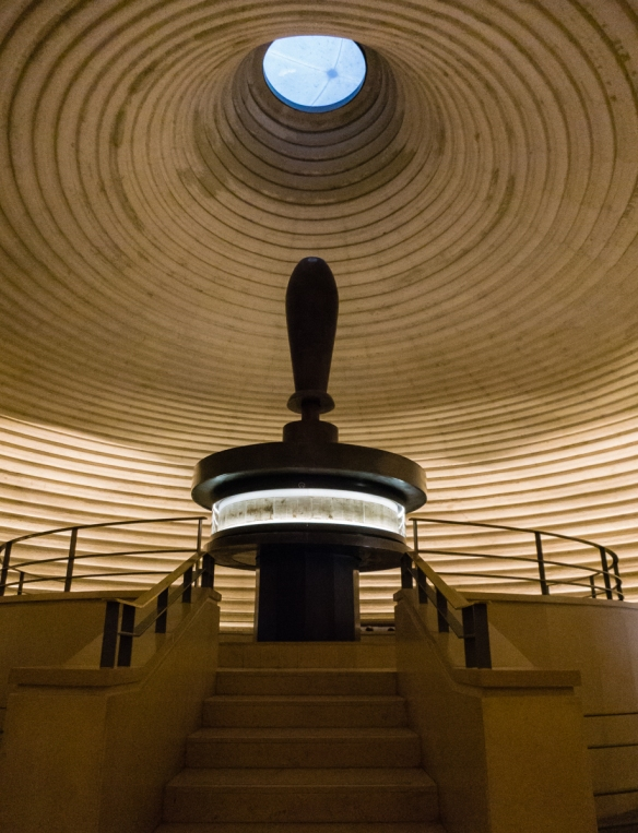 the-inside-of-the-shrine-of-the-book-a-wing-of-the-israel-museum-that-houses-the-dead-sea-scrolls-a-facsimile-of-the-parchment-complete-book-of-isaiah-from-the-bible-is-in-the-center-display
