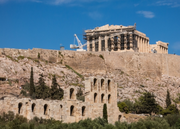 the-parthenon-on-the-hilltop-towers-over-two-large-theaters-the-odeon-of-herodes-atticus-pictured-ruins-and-the-dionysis-theatre-not-pictured-to-the-right-of-the-odeon-the-acropolis-athens