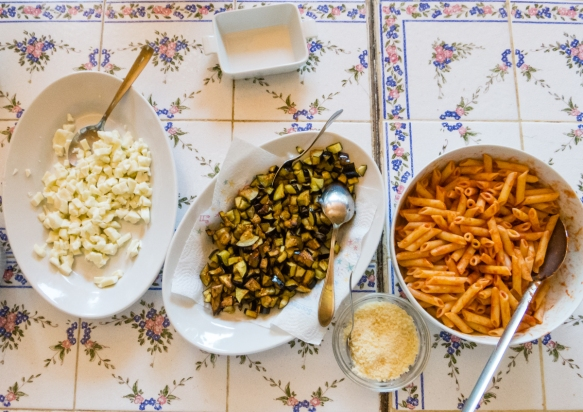 The simple ingredients for our baked pasta-  cooked penne pasta tossed in tomato puree, diced mozzarella cheese, diced eggplant that had been lightly fried (in olive oil), and Parmesan cheese for the top, Villa Ida, Sorrento, Italy