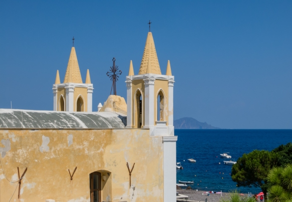 The twin steeples of Santa Marina Salina (Santa Marina Church), dating back to 1622, in the town of Santa Marina, viewed from La Vela restaurant, Isola di Salina, Italy