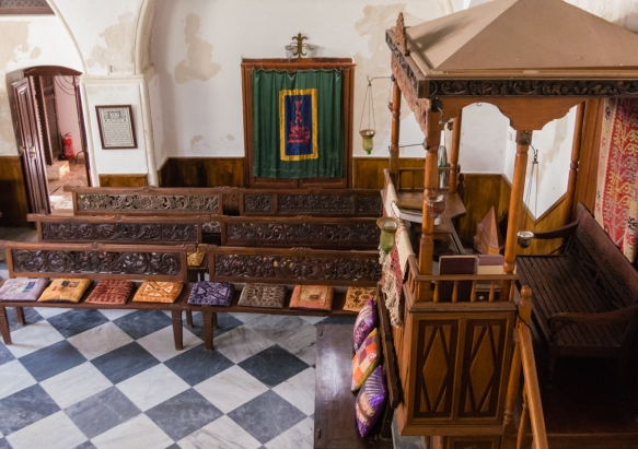 this-photograph-was-made-in-the-current-synagogue-museum-occupying-the-former-northern-womens-prayer-seating-area-upstairs-that-provided-visual-access-to-the-interior-through-a-lattice-work