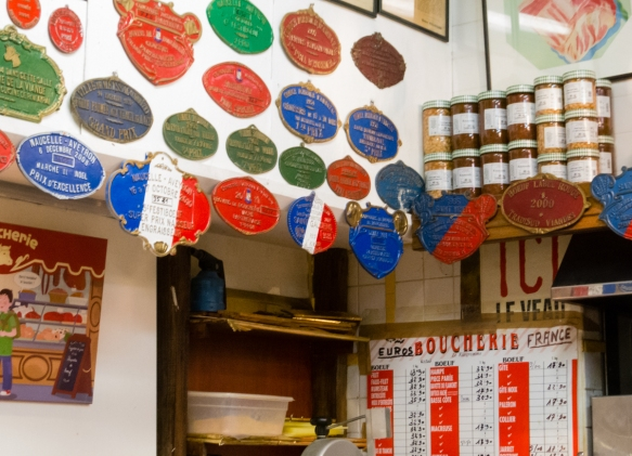 a-portion-of-the-numerous-medals-won-and-displayed-by-the-mof-butcher-at-marche-couvert-des-saint-germain-the-saint-germain-covered-market-paris-by-mouth-taste-of-saint-germain-france