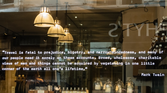 a-shop-window-down-the-street-from-la-derniere-goutte-wine-shop-publicized-a-very-apt-travel-quotation-from-the-19th-century-american-writer-mark-twain-paris-by-mouth-taste-of-saint-germain-f