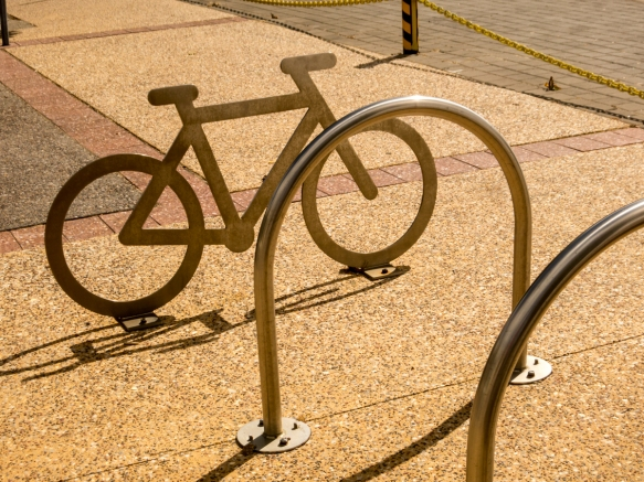 a-really-clever-combination-of-outdoor-sculpture-and-a-signpost-for-the-sidewalk-bicycle-rack-fremantle-australia