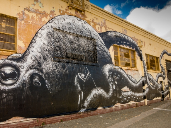 the-giant-squid-painted-by-a-well-know-british-artist-visiting-australia-on-the-side-of-a-former-navy-stores-building-near-the-harbor-in-fremantle-australia