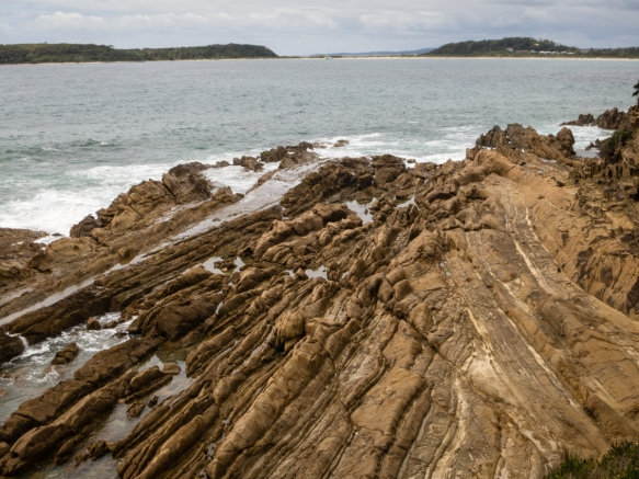 close-up-of-the-striated-eroded-rocky-shoreline-moruya-heads-new-south-wales-australia