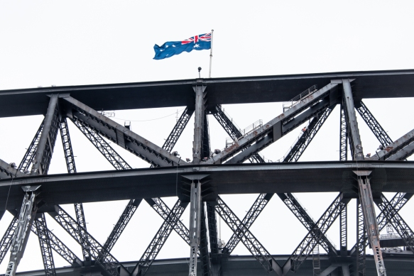 the-australian-flag-proudly-flies-over-the-sydney-harbor-bridge-the-largest-steel-arch-bridge-in-the-world-when-it-opened-in-1932-sydney-new-south-wales-australia
