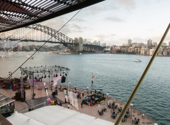 the-view-from-the-sydney-opera-houses-joan-sutherland-theaters-dining-area-on-new-years-eve-overlooking-sydney-harbour-the-sydney-harbour-bridge-and-the-fireworks-launchin