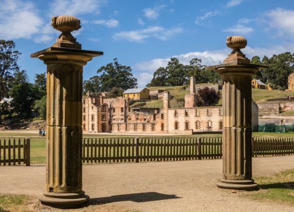 a-view-of-the-penitentiary-and-the-penal-colony-through-columns-marking-the-edge-of-the-community-settlement-of-the-military-and-free-settlers-port-arthur-historic-site-tasmania-australia
