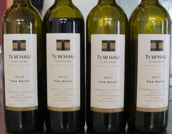 several-different-vintages-of-the-top-te-whau-vineyard-red-wine-the-point-is-served-at-the-winerys-namesake-restaurant-that-overlooks-hitapa-bay-waiheke-island-new-zealand