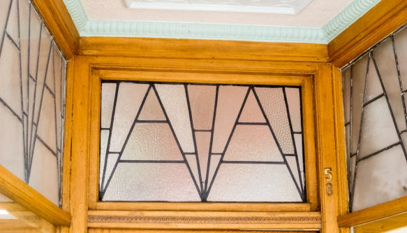 street-level-leaded-glass-designs-above-the-door-of-a-jewelry-shop-napier-new-zealand