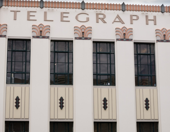 the-daily-telegraph-building-features-many-different-art-deco-design-motifs-including-a-ziggurat-aesthetic-and-trompe-loeil-details-napier-new-zealand