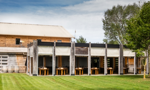 the-dining-room-at-te-awa-on-the-side-of-the-tasting-room-viewed-from-the-vineyards-hawkes-bay-hastings-new-zealand