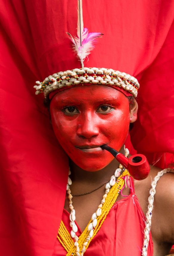 A close up of the young bride with her pipe, Baluan Island, Papua New Guinea