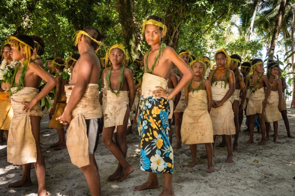 A group of young girl and boy dancers just as they began performing traditional ceremonial dances on Tikopia, Solomon Islands