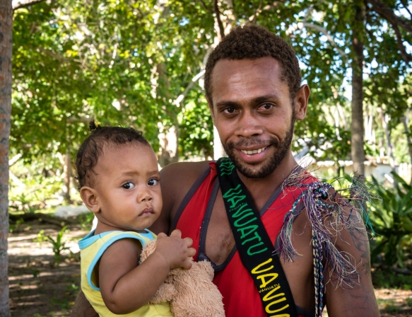 A Mavean father with his daughter on the beach, Mavea Island, Vanuatu