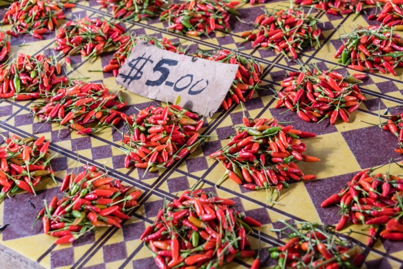 A pile of peppers cost just US$0.70 (at the exchange rate of seven Solomon Island dollars to one US dollar), Central Market, Honiara, Guadalcanal, Solomon Islands; most produce and fruit