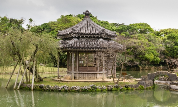 A small island gazebo – a hexaganol Chinese-style building (ROKKAYU-DO) -- in the pond in front of the residence that is part of the Shikinaen Royal Garden, Naha, Okinawa, Japan
