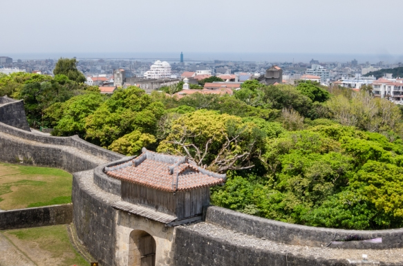 A view of the town and port of Naha from the upper level of the west side lookout (IRI-NO-AZANA) of the reconstructed Ryukyu Castle located in the hills of Naha, Okinawa, Japan