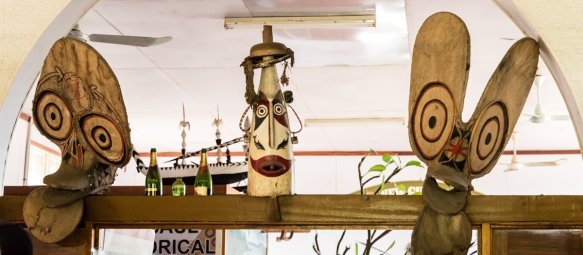 At the former New Guinea Club building in Rabaul, that is now a museum, the masks on the left and right are from a Baining fire dance performance, Papua New Guinea